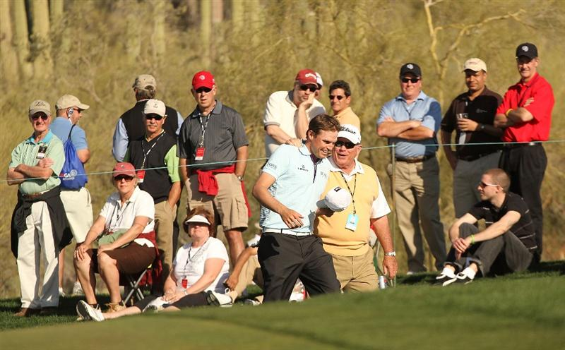 MARANA, AZ - FEBRUARY 18:  Nick Watney and Butch Harmon on the 17th hole during round two of the Accenture Match Play Championship at the Ritz-Carlton Golf Club on February 18, 2010 in Marana, Arizona.  (Photo by Darren Carroll/Getty Images)