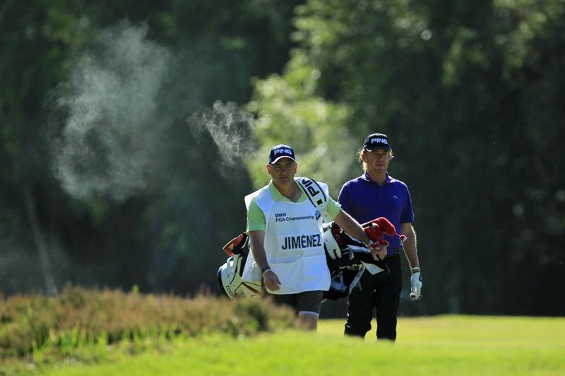 VIRGINIA WATER, ENGLAND - MAY 25:  Miguel Angel Jiminez of Spain smokes a cigar whilst walking with his caddie during the Pro-Am round prior to the BMW PGA Championship at Wentworth Club on May 25, 2011 in Virginia Water, England.  (Photo by David Cannon/Getty Images)