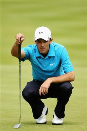 VIRGINIA WATER, ENGLAND - MAY 21:  Charles Schwartzel of South Africa lines up a putt at the 18th during the second round of the BMW PGA Championship on the West Course at Wentworth on May 21, 2010 in Virginia Water, England.  (Photo by Warren Little/Getty Images)