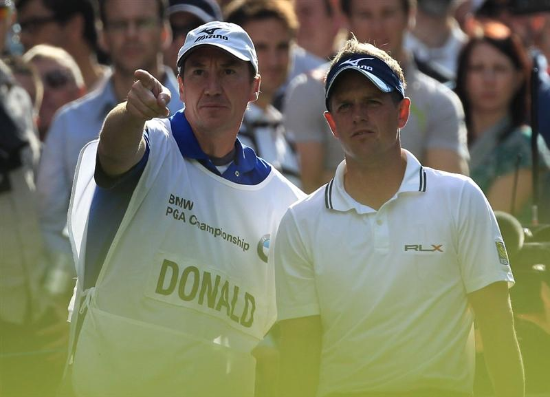 VIRGINIA WATER, ENGLAND - MAY 29:  Luke Donald of England lines up a shot with his caddie John McLaren during the final round of the BMW PGA Championship  at the Wentworth Club on May 29, 2011 in Virginia Water, England.  (Photo by David Cannon/Getty Images)