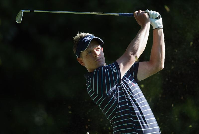 VIRGINIA WATER, ENGLAND - MAY 25:  Luke Donald of England  hits an approach shot during the Pro-Am round prior to the BMW PGA Championship at Wentworth Club on May 25, 2011 in Virginia Water, England.  (Photo by Ross Kinnaird/Getty Images)