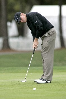 Jason Bohn puts in a birdie on the 9th green during the first round of the MCI Heritage at Harbour Town Golf Links April 14, 2005, at Hilton Head Island.  Bohn finished with an even par 71.Photo by Al Messerschmidt/WireImage.com