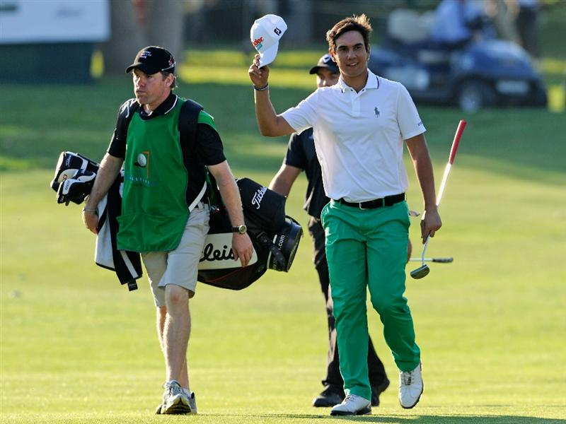 CASTELLON DE LA PLANA, SPAIN - OCTOBER 24:  Matteo Manassero of Italy celebrates with his caddie on the 18th hole during the final round of the Castello Masters Costa Azahar at the Club de Campo del Mediterraneo on October 24, 2010 in Castellon de la Plana, Spain.  (Photo by Stuart Franklin/Getty Images)