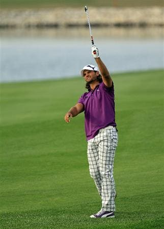 BAHRAIN, BAHRAIN - JANUARY 29:  Johan Edfors of Sweden plays his second shot to the 18th hole during the third round of the 2011 Volvo Champions held at the Royal Golf Club on January 29, 2011 in Bahrain, Bahrain.  (Photo by David Cannon/Getty Images)