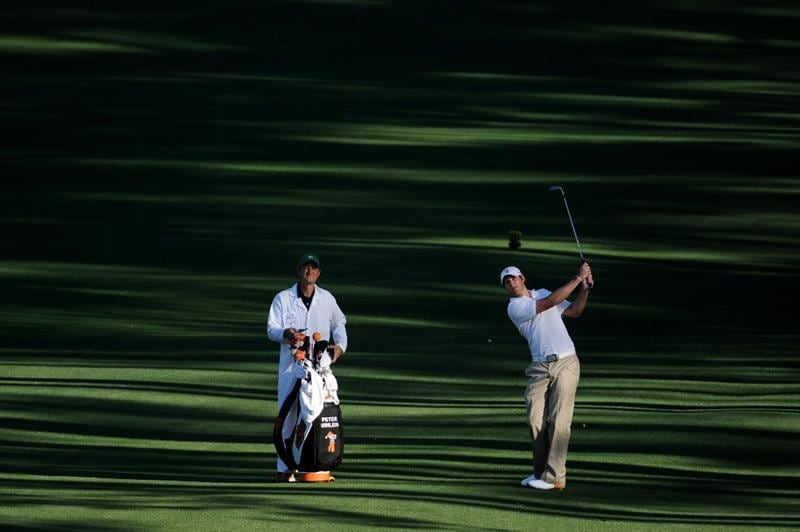 AUGUSTA, GA - APRIL 04:  Amateur Peter Uihlein plays a shot as his caddie looks on during a practice round prior to the 2011 Masters Tournament at Augusta National Golf Club on April 4, 2011 in Augusta, Georgia.  (Photo by Harry How/Getty Images)