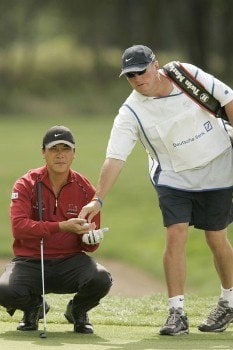 Lian-Wei Zhang reads a putt during the rain delayed first round of the 2005 Deutsche Bank Players' Championship at Gut Kaden Golf Club in Hamburg, Germany on July 22, 2005.Photo by Pete Fontaine/WireImage.com