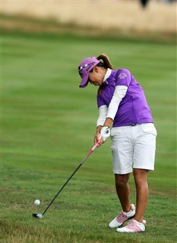 SUNNINGDALE, UNITED KINGDOM - AUGUST 02:  Momoko Ueda of Japan plays her second shot at the 1st hole during the third round of the 2008  Ricoh Women's British Open Championship held on the Old Course at Sunningdale Golf Club, on August 2, 2008 in Sunningdale, England.  (Photo by David Cannon/Getty Images)