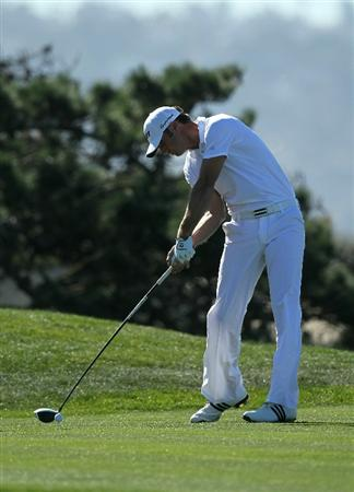 LA JOLLA, CA - JANUARY 27:  Dustin Johnson hits his tee shot on the fourth hole during round one of the Farmers Insurance Open at Torrey Pines South Course on January 27, 2011 in La Jolla, California.  (Photo by Stephen Dunn/Getty Images)