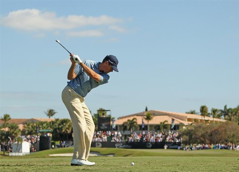DORAL, FL - MARCH 13:  Matt Kuchar hits his tee shot on the ninth hole during the final round of the 2011 WGC- Cadillac Championship at the TPC Blue Monster at the Doral Golf Resort and Spa on March 13, 2011 in Doral, Florida.  (Photo by Mike Ehrmann/Getty Images)
