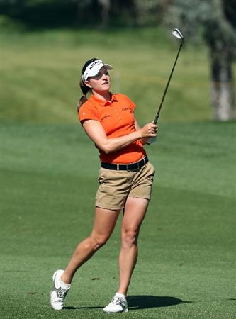 RANCHO MIRAGE, CA - APRIL 02:  Brittany Lang of the USA plays her second shot at the 12th hole during the first round of the 2009 Kraft Nabisco Championship, at the Mission Hills Country Club on April 2, 2009 in Rancho Mirage, California.  (Photo by David Cannon/Getty Images)