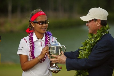Jennifer Rosales receives the winner's trophie from the SBS President at the LPGA SBS Open held at the Turtle Bay Resort on Oahu. February 26, 2005 in Kahuku, Hawaii.