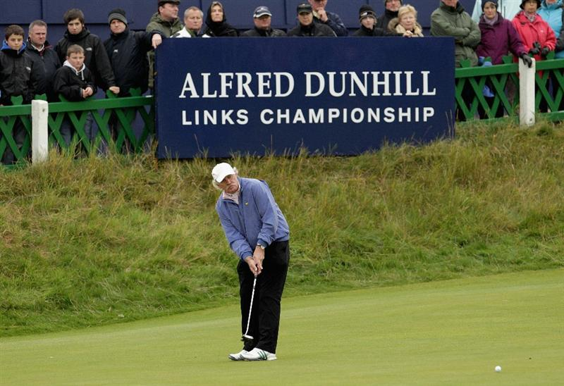 ST ANDREWS, SCOTLAND - OCTOBER 10:  Irish businessman Dermot Desmond putting on the 18th green during the final round of The Alfred Dunhill Links Championship at The Old Course on October 10, 2010 in St Andrews, Scotland.  (Photo by Andrew Redington/Getty Images)
