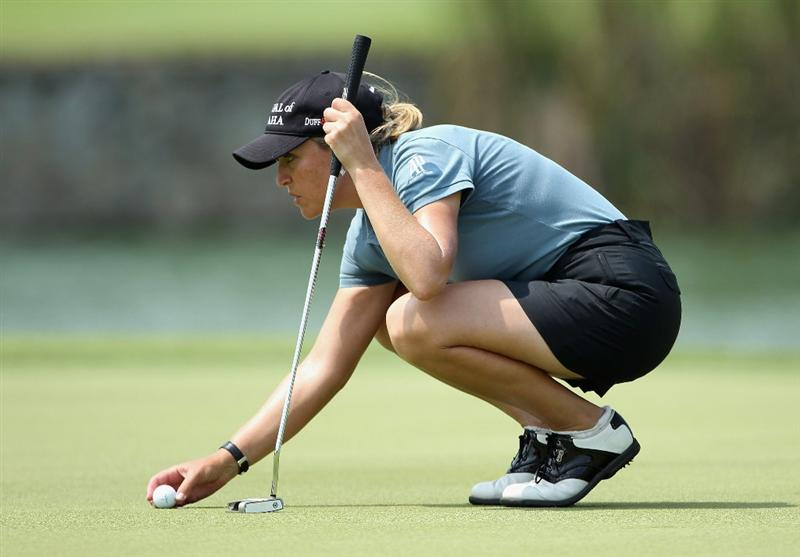 SINGAPORE - FEBRUARY 24:  Cristie Kerr of the USA in action during the first round of the HSBC Women's Champions at the Tanah Merah Country Club on February 24, 2011 in Singapore.  (Photo by Andrew Redington/Getty Images)