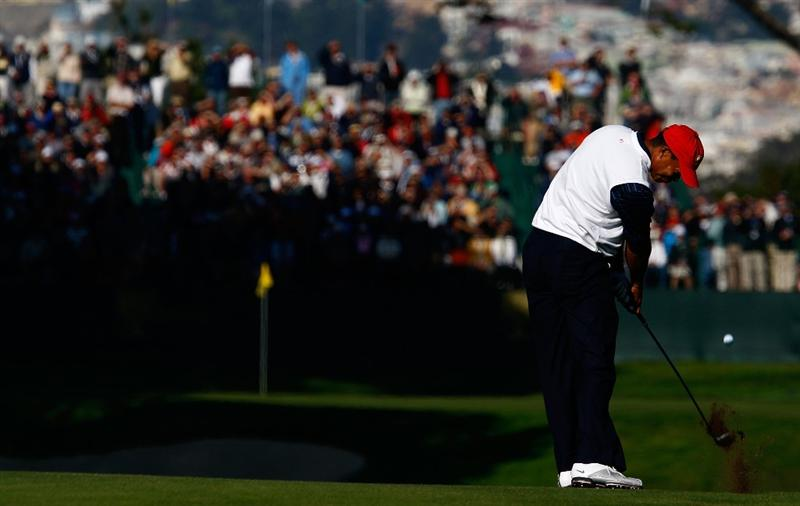 SAN FRANCISCO - OCTOBER 09:  Tiger Woods of the USA Team hits his approach shot on the 15th hole during the Day Two Fourball Matches of The Presidents Cup at Harding Park Golf Course on October 9, 2009 in San Francisco, California.  (Photo by Scott Halleran/Getty Images)