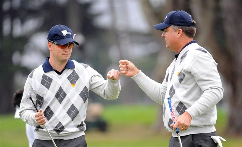 SAN FRANCISCO - OCTOBER 10:  Zach Johnson and Kenny Perry of the USA Team celebrate on the fourth green during the Day Three Morning Foursome Matches of The Presidents Cup at Harding Park Golf Course on October 10, 2009 in San Francisco, California.  (Photo by Harry How/Getty Images)