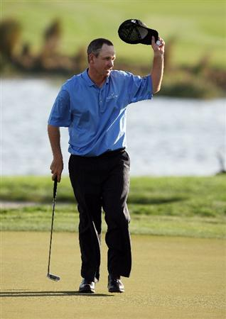 PALM BEACH GARDENS, FL - MARCH 07:  Jeff Klauk acknowledges the crowd on the 18th green after finishing the third round of The Honda Classic at PGA National Resort and Spa on March 7, 2009 in Palm Beach Gardens, Florida.  (Photo by Doug Benc/Getty Images)