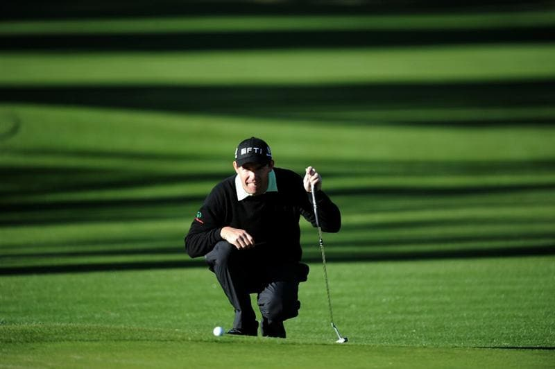 PACIFIC PALISADES, CA - FEBRUARY 17:  Padraig Harrington of Ireland lines up his putt on the 11th hole during the first round of the Northern Trust Open at the Riviera Country Club on February 17, 2011 in Pacific Palisades, California.  (Photo by Harry How/Getty Images)