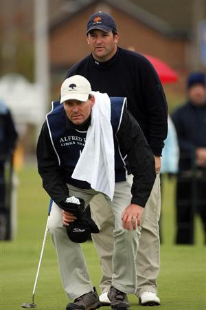 CARNOUSTIE, SCOTLAND - OCTOBER 02:  David Dixon of England and his caddie (front) line up a putt on the 18th hole during the second round of The Alfred Dunhill Links Championship at Carnoustie Golf Club on October 2, 2009 in Carnoustie, Scotland.  (Photo by Andrew Redington/Getty Images)