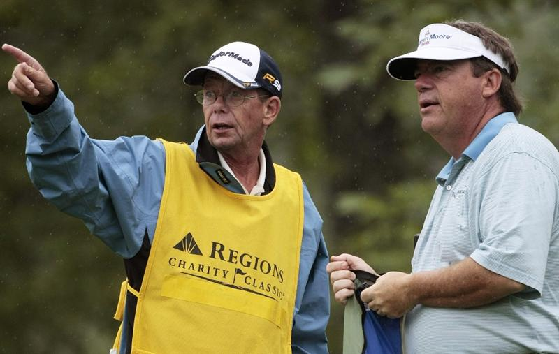 BIRMINGHAM, AL - MAY 16:  Joey Sindelar (R) talks with his caddie John Buchna on the first tee after play was suspended because of weather during the second round of the Regions Charity Classic at the Robert Trent Jones Golf Trail at Ross Bridge on May 16, 2009 in Birmingham, Alabama. (Photo by Dave Martin/Getty Images)