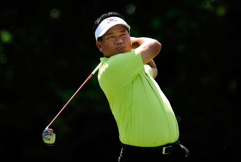 PONTE VEDRA BEACH, FL - MAY 08:  K.J. Choi of South Korea hits his tee shot on the seventh hole during the third round of THE PLAYERS Championship held at THE PLAYERS Stadium course at TPC Sawgrass on May 8, 2010 in Ponte Vedra Beach, Florida.  (Photo by Sam Greenwood/Getty Images)