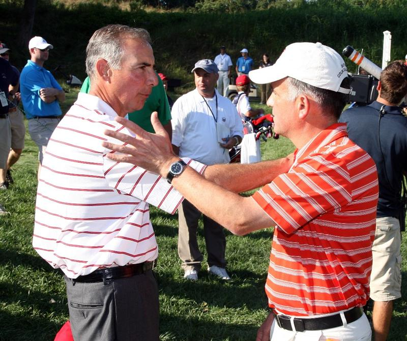 ARDMORE, PA - SEPTEMBER 13: Buddy Marucci the USA team captain is congratulated by Colin Dalgleish the Great Britain and Ireland captain after the USA had secured victory during the final afternoon singles matches on the East Course at Merion Golf Club on September 13, 2009 in Ardmore, Pennsylvania  (Photo by David Cannon/Getty Images)