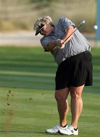 DUBAI, UNITED ARAB EMIRATES - DECEMBER 12:  Laura Davies of England plays her second shot at the 16th hole during the second round of the Dubai Ladies Masters on the Majilis Course at the Emirates Golf Club on December 12, 2008 in Dubai,United Arab Emirates  (Photo by David Cannon/Getty Images)