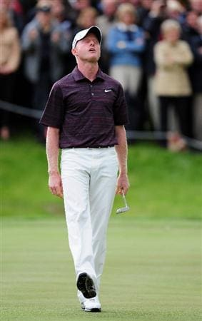 COLOGNE, GERMANY - SEPTEMBER 13:  Simon Dyson of England reacts to his puttt on the 18th hole during the final round of The Mercedes-Benz Championship at The Gut Larchenhof Golf Club on September 13, 2009 in Cologne, Germany.  (Photo by Stuart Franklin/Getty Images)
