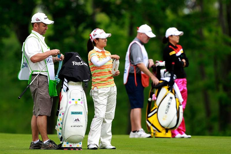 GLADSTONE, NJ - MAY 20: Ai Miyazato of Japan (L) stands on the first fairway with her opponent Hee-Won Han of South Korea (R) during round two of the Sybase Match Play Championship at Hamilton Farm Golf Club on May 20, 2011 in Gladstone, New Jersey.  (Photo by Chris Trotman/Getty Images)