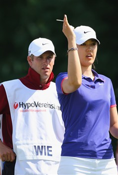 MUNICH, GERMANY - MAY 30:  Michelle Wie of USA and caddie Tim Vickers during the second round of the Hypo Vereinsbank Ladies German Open Golf at Golfpark Gut Hausern on May 30, 2008 near Munich, Germany.  (Photo by Stuart Franklin/Bongarts/Getty Images)
