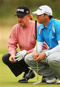 SOUTHPORT, UNITED KINGDOM - JULY 15:  Sergio Garcia of Spain lines up a putt with Miguel Angel Jimenez of Spain during the second practice round of the 137th Open Championship on July 15, 2008 at Royal Birkdale Golf Club, Southport, England.  (Photo by Andrew Redington/Getty Images)