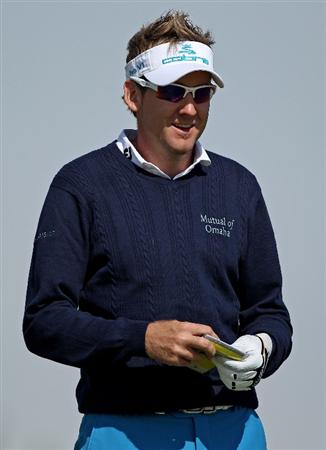 DOHA, QATAR - JANUARY 27:  Ian Poulter of England smiles on the 11th hole during the Pro Am prior to the start of the Commercialbank Qatar Masters at Doha Golf Club on January 27, 2010 in Doha, Qatar.  (Photo by Andrew Redington/Getty Images)