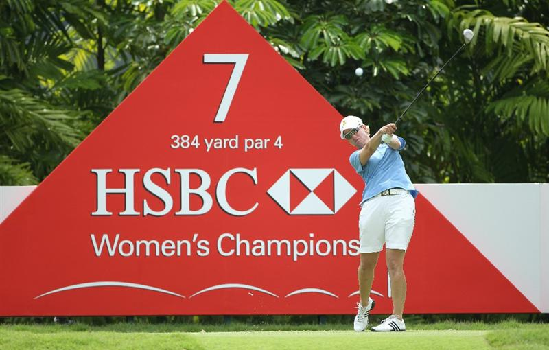 SINGAPORE - FEBRUARY 27:  Karrie Webb of Australia hits her tee-shot on the seventh hole during the final round of the HSBC Women's Champions at the Tanah Merah Country Club on February 27, 2011 in Singapore.  (Photo by Andrew Redington/Getty Images)