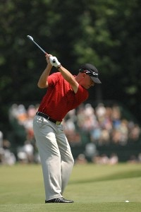 SILVIS, IL - JULY 14:  Nathan Green hits his approach shot into the 9th hole  during the third round of The John Deere Classic at the TPC Deere Run on July 14, 2007 in Silvis, Illinois.   (Photo by Marc Feldman/WireImage) *** Local Caption *** Nathan Green PGA TOUR - 2007 John Deere Classic - Third RoundPhoto by Marc Feldman/WireImage) *** Local Caption *** Nathan Green