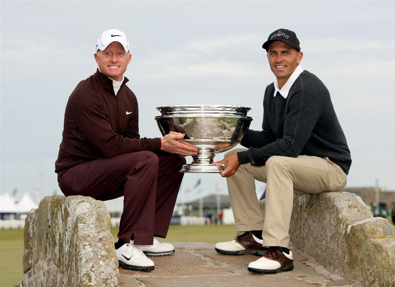 ST ANDREWS, SCOTLAND - OCTOBER 05:  Simon Dyson of England and his playing partner Kelly Sltaer hold the trophy aloft after victory at the The Alfred Dunhill Links Championship at The Old Course on October 5, 2009 in St.Andrews, Scotland.  (Photo by Andrew Redington/Getty Images)