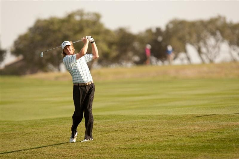 SAN ANTONIO, TX - APRIL 16: Tim Petrovic follows through on an approach shot during the third round of the Valero Texas Open at the AT&T Oaks Course at TPC San Antonio on April 16, 2011 in San Antonio, Texas. (Photo by Darren Carroll/Getty Images)
