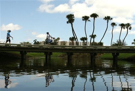 AVENTURA, FL - APRIL 24:  Annika Sorenstam (L) of Sweden makes her way across a bridge in between holes during the first round of the Stanford International Pro-Am at Fairmont Turnberry Isle Resort & Club April 24, 2008 in Aventura, Florida.  (Photo by Doug Benc/Getty Images)
