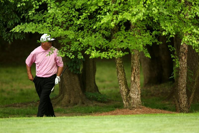 CHARLOTTE, NC - MAY 01:  Paul Goydos walks out of the trees after a shot on the 12th hole during the third round of the Quail Hollow Championship at Quail Hollow Country Club on May 1, 2010 in Charlotte, North Carolina.  (Photo by Streeter Lecka/Getty Images)