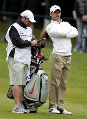 VIRGINIA WATER, ENGLAND - MAY 28:  Paul Casey of England waits with caddie Craig Connelly during the third round of the BMW PGA Championship at the Wentworth Club on May 28, 2011 in Virginia Water, England.  (Photo by Ross Kinnaird/Getty Images)