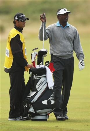 TURNBERRY, SCOTLAND - JULY 19:  Vijay Singh of Fiji discusses a shot with Caddy Chad Reynolds during the final round of the 138th Open Championship on the Ailsa Course, Turnberry Golf Club on July 19, 2009 in Turnberry, Scotland.  (Photo by Ross Kinnaird/Getty Images)