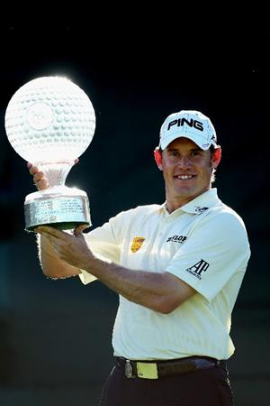 SUN CITY, SOUTH AFRICA - DECEMBER 05:  Lee Westwood of England poses with the trophy after winning the 2010 Nedbank Golf Challenge at the Gary Player Country Club Course  on December 5, 2010 in Sun City, South Africa.  (Photo by Warren Little/Getty Images)