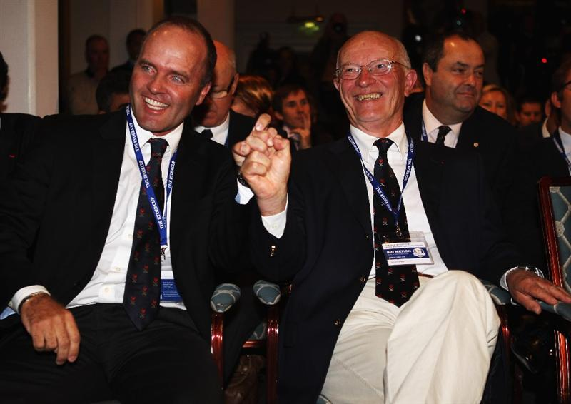 VIRGINIA WATER, ENGLAND - MAY 17: Past Ryder Cup player Thomas Levet (l) and Chairman of the French Golf Federation Georges Barbaret celebrate after France won the bid to host the 2018 Ryder Cup, at Wentworth on May 17, 2011 in Virginia Water, England.  (Photo by Bryn Lennon/Getty Images)