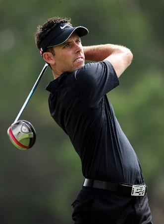 JOHANNESBURG, SOUTH AFRICA - JANUARY 17:  Charl Schwartzel of South Africa plays his tee shot on the fourth hole during the final round of the Joburg Open at Royal Johannesburg and Kensington Golf Club on January 17, 2010 in Johannesburg, South Africa.  (Photo by Stuart Franklin/Getty Images)
