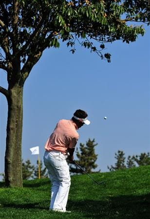 JEJU, SOUTH KOREA - APRIL 23:  Thongchai Jaidee of Thailand plays his chip shot on the 14th hole during the first round of the Ballantine's Championship at Pinx Golf Club on April 23, 2009 in Jeju, South Korea.  (Photo by Stuart Franklin/Getty Images)