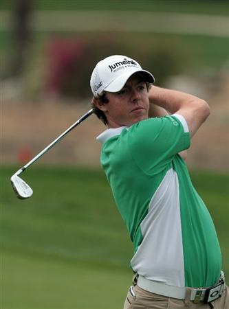 ABU DHABI, UNITED ARAB EMIRATES - JANUARY 21: Rory McIroy of Northern Ireland plays his second shot on the 9th hole during the second round of the 2011 Abu Dhabi HSBC Golf Championship held at the Abu Dhabi Golf Club on January 21, 2011 in Abu Dhabi, United Arab Emirates.  (Photo by David Cannon/Getty Images)