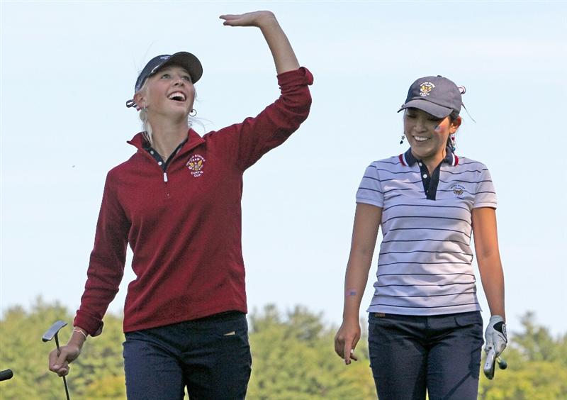 MANCHESTER, MA - JUNE 11: Jessica Korda, left, and Tiffany Lua of the United States react to fans during Four-Balls  competition of the 2010 Curtis Cup Match at the Essex Country Club on June 11, 2010 in Manchester, Massachusetts. (Photo by Jim Rogash/Getty Images)
