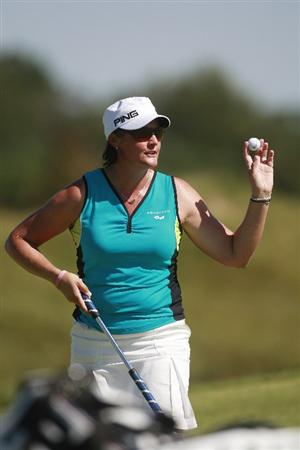 PRATTVILLE, AL - OCTOBER 3:   Maria Hjorth of Sweden waves after making her putt on the ninth green during third round play in the Navistar LPGA Classic at the Robert Trent Jones Golf Trail at Capitol Hill on October 3, 2009 in  Prattville, Alabama.  (Photo by Dave Martin/Getty Images)