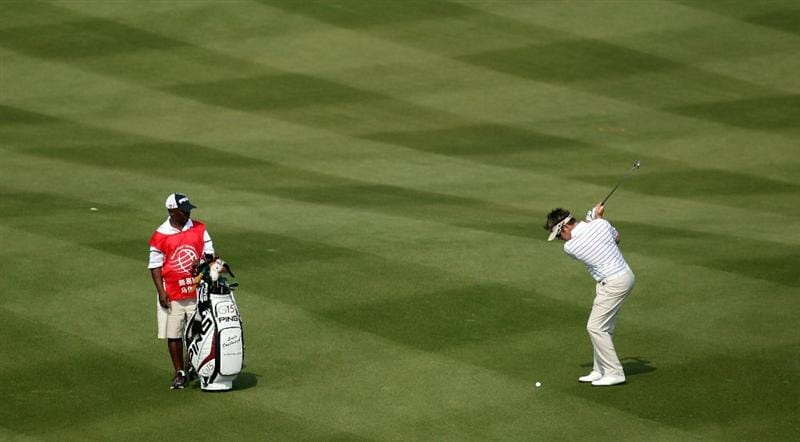 SHANGHAI, CHINA - NOVEMBER 05:  Louis Oosthuizen of South Africa on the 2nd fairway during the second round of the WGC - HSBC Champions at Sheshan International Golf Club on November 5, 2010 in Shanghai, China.  (Photo by Ross Kinnaird/Getty Images)