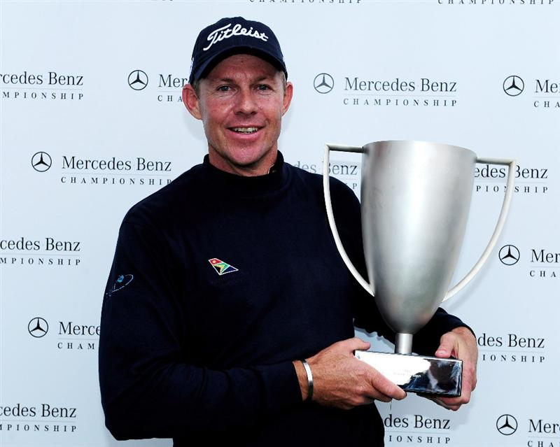 COLOGNE, GERMANY - SEPTEMBER 13:  James Kingston of South Africa holds the winners trophy after winning the playoff against Ander Hansen of Denmark during the final round of The Mercedes-Benz Championship at The Gut Larchenhof Golf Club on September 13, 2009 in Cologne, Germany.  (Photo by Stuart Franklin/Getty Images)