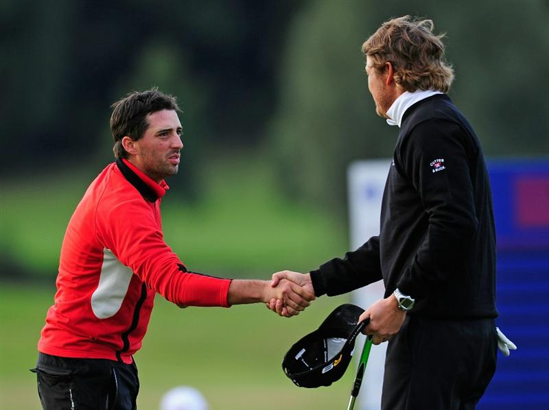 PARIS - SEPTEMBER 25:  John Parry of England shakes hands with playing partner Jarmo Sandelin of Sweden during the third round of the Vivendi cup at Golf de Joyenval on September 25, 2010 in Chambourcy, near Paris, France.  (Photo by Stuart Franklin/Getty Images)