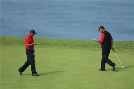 SAN DIEGO - JUNE 16:  Rocco Mediate (R) and Tiger Woods line up putts on the third hole during the playoff round of the 108th U.S. Open at the Torrey Pines Golf Course (South Course) on June 16, 2008 in San Diego, California.  (Photo by Doug Pensinger/Getty Images)